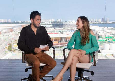 Presenter asking a famous female celebrity at tv studio