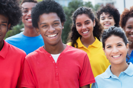 latina america: Mixed group of happy multiethnic young adults