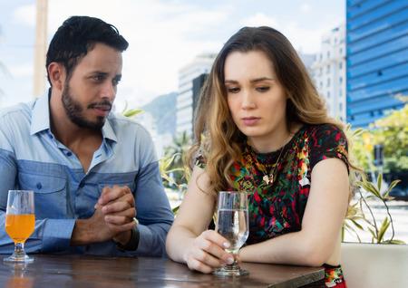 Man wants forgiveness from sad woman Stock Photo