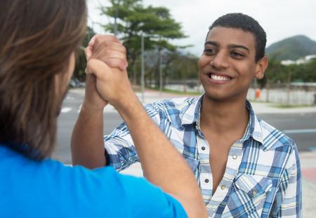 african american handshake: Handshake of an african american man with caucasian friend
