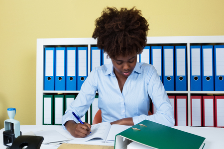 Working african american businesswoman at office Stock Photo