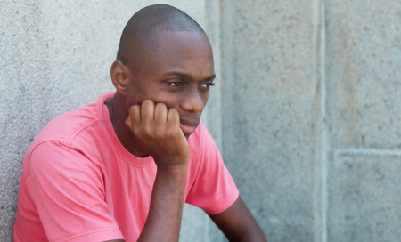 Sad and hairless african american man outdoor in the summer Stock Photo