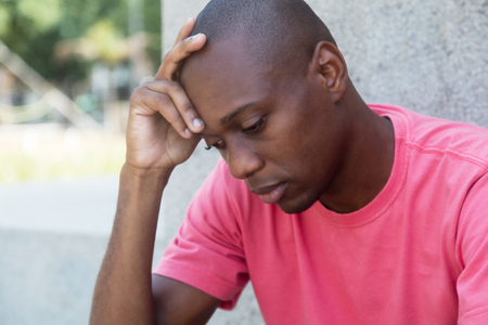 Hairless african american man in depression outdoor in the summer
