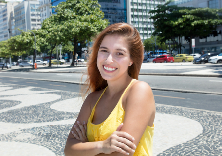 smile close up: Young caucasian woman with red outdoor in the city in the summer