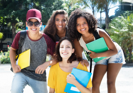Group of hip multi ethnic brazilian students outdoor in the city in the summer