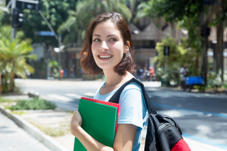 Beautiful caucasian female student in the city in the summer