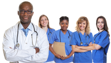 African american doctor with crossed arms and group of international nurses on isolated white background Stock fotó - 85545085