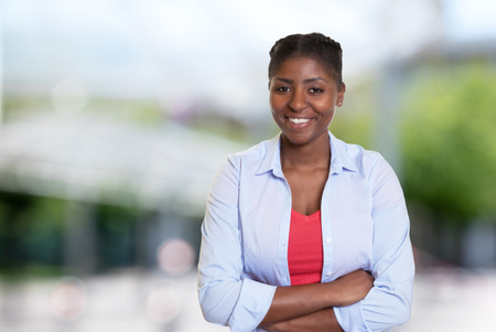 Laughing young african american woman with casual clothes outdoors