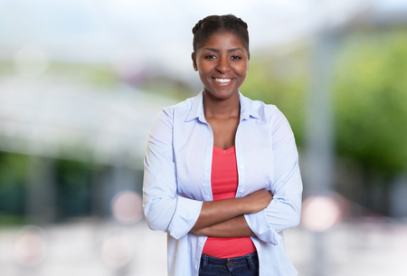 Joyful laughing african american woman with casual clothes outdoors Stock Photo