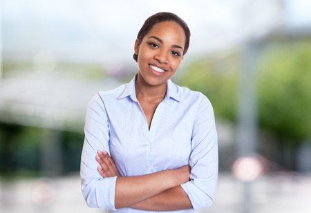 Beautiful african american businesswoman outdoors in summer
