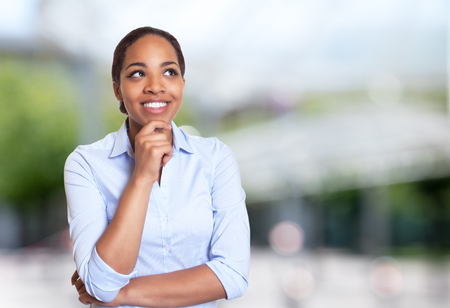 Creative african american businesswoman outdoors in summer Stock Photo