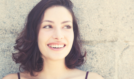 typical: Laughing caucasian woman with long dark hair in vintage retro look