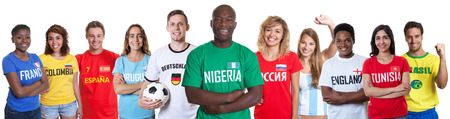 Soccer fan from Nigeria with fans from other countries Stock Photo