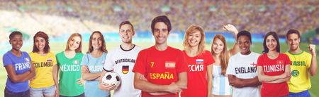 Soccer supporter from Spain with fans other countries at stadium Stock Photo