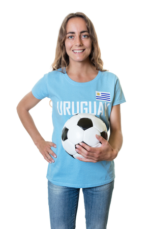 Laughing soccer fan from Uruguay with ball