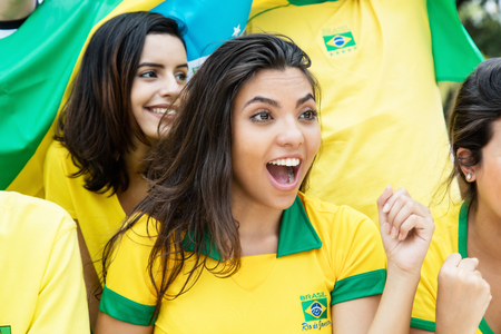 Woman from Brazil with other brazilian soccer fans at stadium