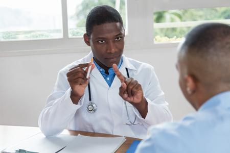 African american doctor recommending no smoking Standard-Bild
