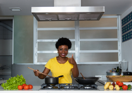 African american woman cooking at kitchen