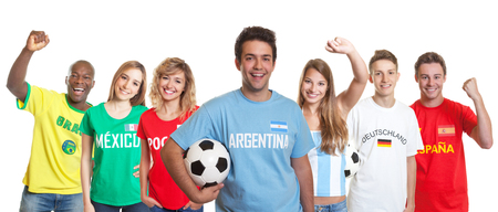 Argentinian soccer supporter with ball and fans from other countries Stock Photo
