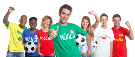 Optimistic mexican soccer supporter with ball and fans from other countries
