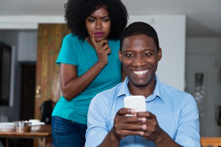 Jealousy african american woman distrust her boyfriend Stock fotó