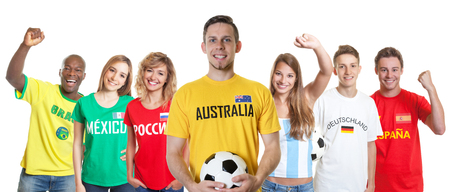 Australian soccer supporter with fans from other countries Stock Photo