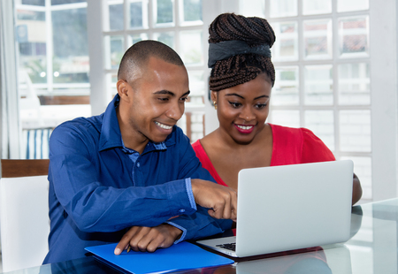 African american couple at computer