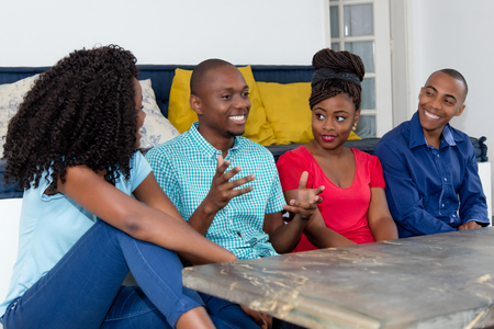 Happy african american people talking about sports and politics Stock Photo
