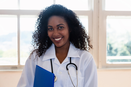 Pretty latin american nurse with file of patient