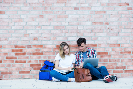 German male and female student with copy space