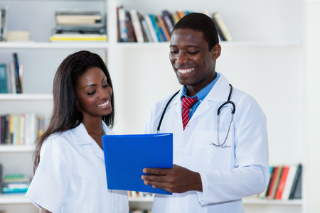 Laughing african american male and female doctor