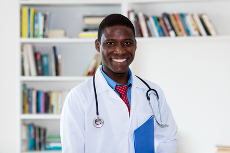 Laughing african american male doctor
