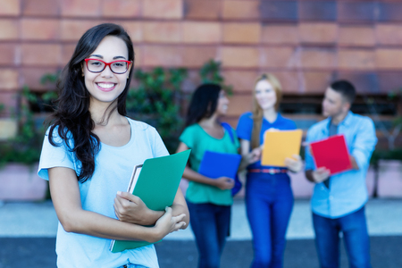 Nerdy french female student with group of students Stock Photo