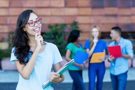 Dreaming nerdy french female student with group of students Stock Photo