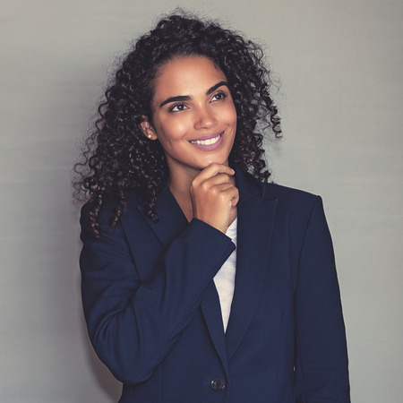 Portrait of a thinking latin american businesswoman