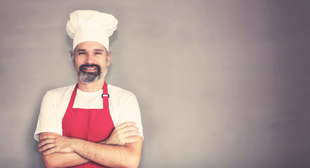 Handsome mature chef with beard and copy space 写真素材