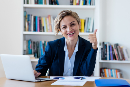 Successful mature businesswoman working on computer 版權商用圖片