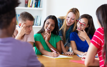 Group of laughing international students in discussion