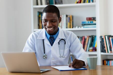 Laughing african american mature general practitioner Stock Photo