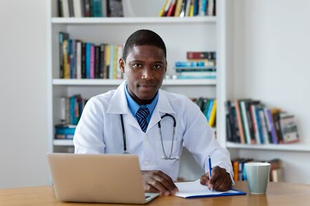 African american mature male doctor Stock Photo