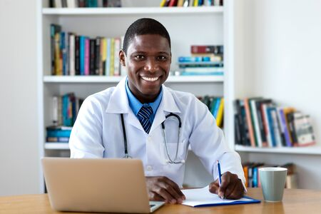 Laughing african american mature male doctor