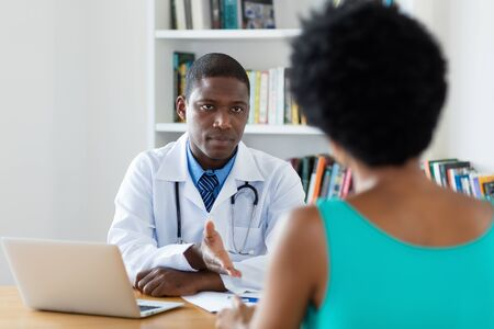 African american doctor has bad news for patient