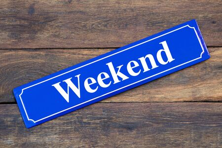 Weekend street sign on wooden background
