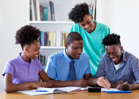 African american teacher learning with students