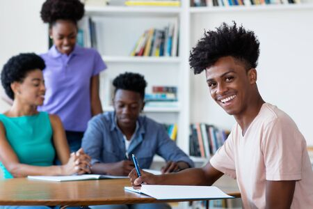 Young african american male student learning at desk at school Stock Photo
