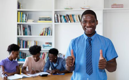 African american teacher with pupils at school Stock Photo