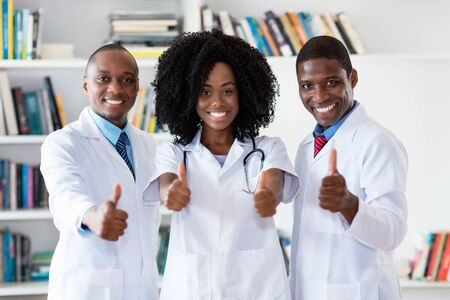 African american doctor and general practitioner and nurse as medical team Stock Photo