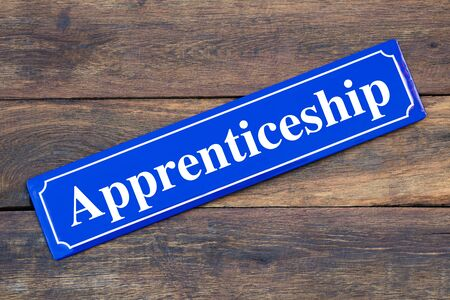 Apprenticeship street sign on wooden background Stock Photo - 127363835
