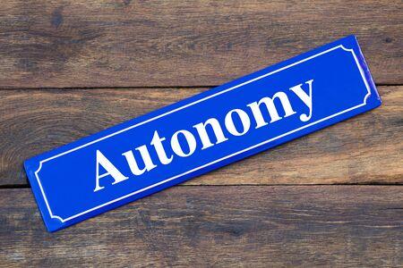Autonomy street sign on wooden background