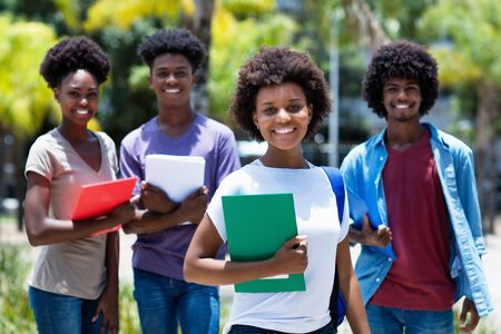 Pretty african amerlcan female university student with group of african american students